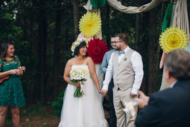 Jared went for a casual, vintage look in a tan vest suit with a chambray bow tie. His wooden boutonniere suited the woodland setting.