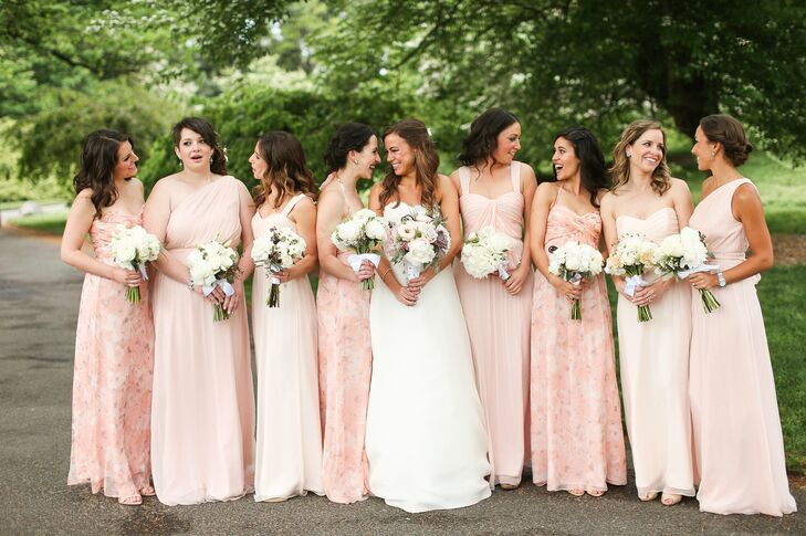 """I didn't want all the bridesmaids to wear the same thing, but I wanted some level of cohesion,"" Lauren says. With eight bridesmaids accompanying her down the aisle, she decided it would be easiest to choose a few colors and styles. Amsale offered the variety and sophisticated aesthetic she was after. She ultimately chose two shades of pale pink and one peach floral print, and allowed the girls to choose their own silhouette. ""I love how they all looked together and how the print offered a twist on the standard pink bridesmaid look,"" Lauren says."