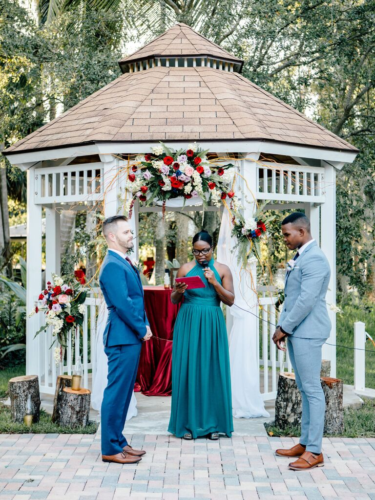Grooms reciting vows at wedding ceremony