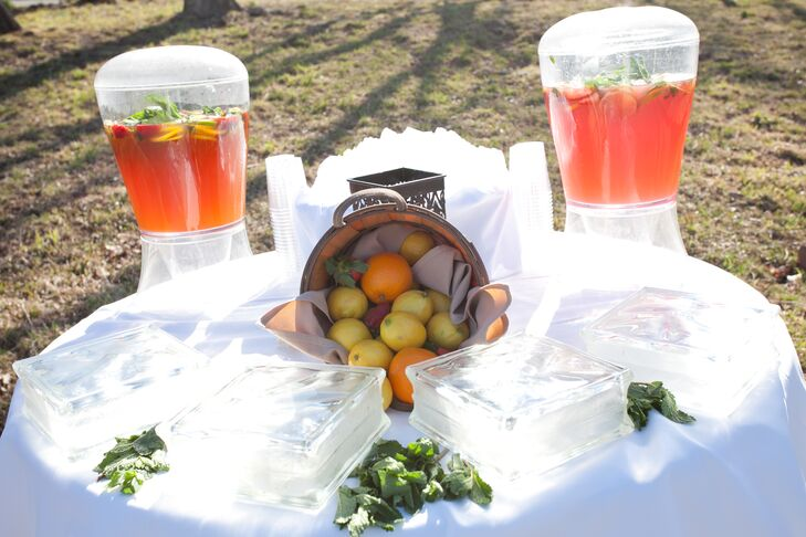 """We had a pre-ceremony beverage station set up with brewed sweet tea and fresh-squeezed lemonade paired with fruit infused water,"" Lisa says. ""Our cocktail hour was held in a tent adjacent to the barn and the reception was held in the actual barn. All aspects of the wedding were rustic, a little fancy and certainly fun!"""