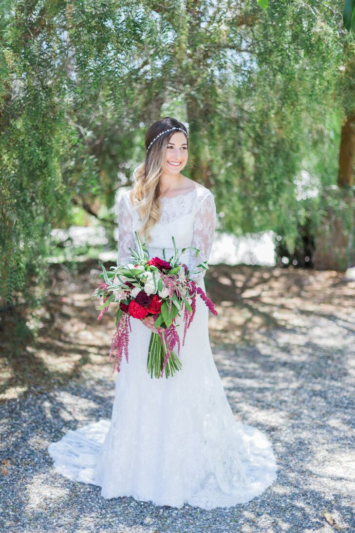"""I went with the classic look mixed with my bohemian style,"" Jenna Mae says. ""I love long-sleeve dresses, so that was a must."" Jenna Mae's bountiful bouquet was a combination of crimson roses, greenery and dripping hyacinths."