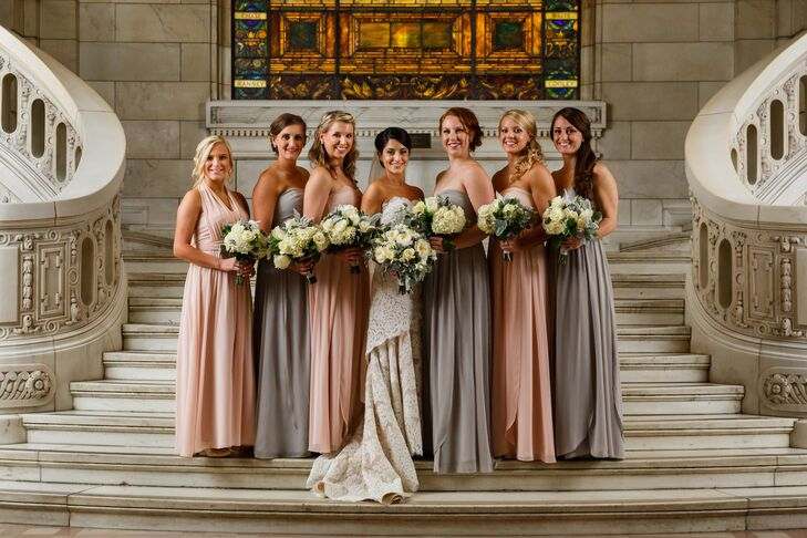 Lisa stood in the middle of her bridesmaids, who wore pink and gray long dresses designed by Jenny Yoo that were purchased from Nordstrom. They all held their bouquets of ivory roses and hydrangeas.