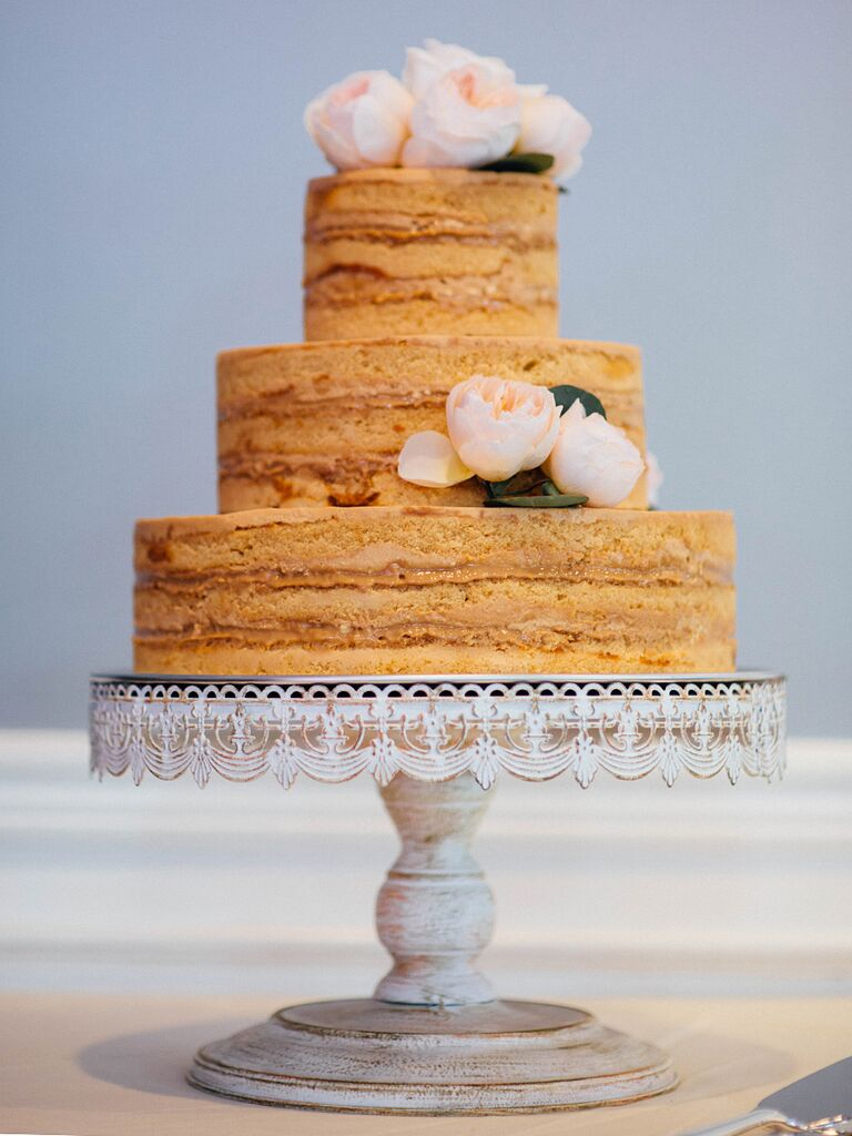 Nearly naked boho wedding cake with garden roses
