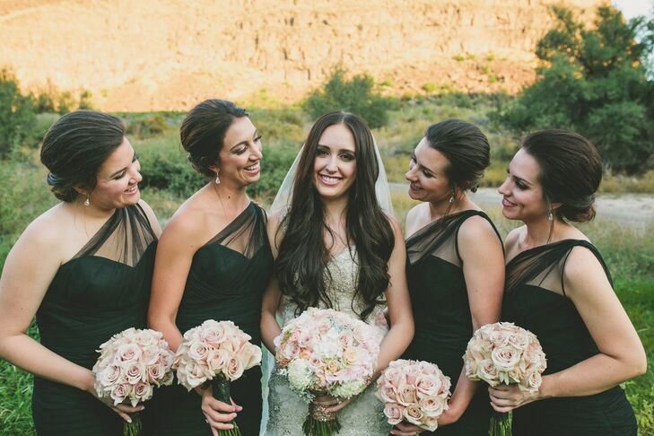 For the wedding party, Elle's bridesmaids wore designer black Amsale one-shoulder tulle mermaid-style gowns with simple black patent heels. Their blush and ivory bouquets were similar to Elle's.