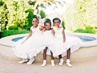 Flower girls wearing white flower girl shoes