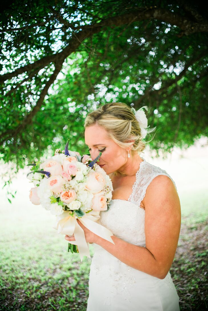 Megan chose a romantic bouquet from Oneco Florist with a few whimsical accents for her wedding day. It was filled with soft blush garden roses, white and pink roses and white hydrangeas as purple veronica popped from the arrangement. All of the blooms were wrapped with a sweet ivory ribbon.