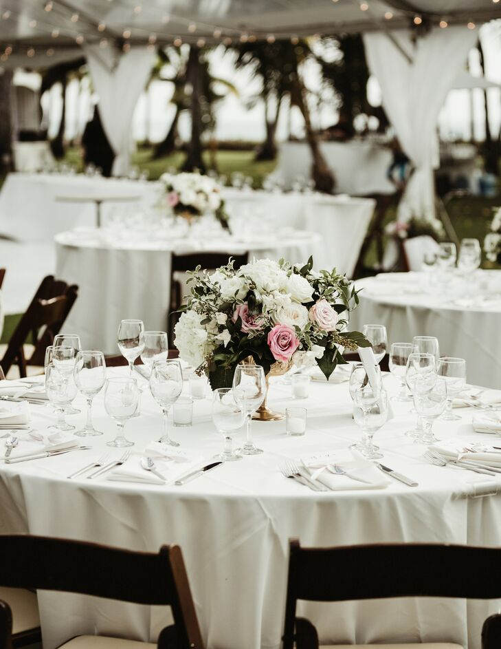 Su-V Expressions created low, greenery-rich centerpieces to top the tables at the reception at Lanikuhonua Cultural Institute in Kapolei, Hawaii.
