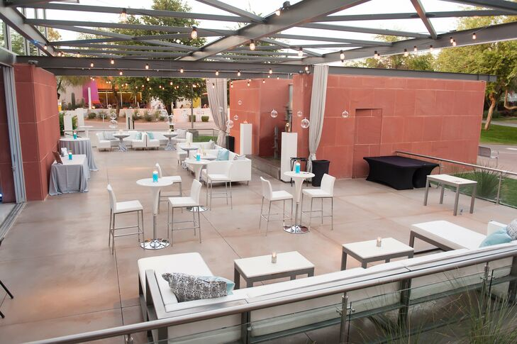 The patio overlooking the park, where Brianna and Ryan's cocktail hour took place, offered plenty of modern lounge furniture and space to mingle as guests snacked on appetizers and sipped beverages such as the red berry sangria signature cocktail.