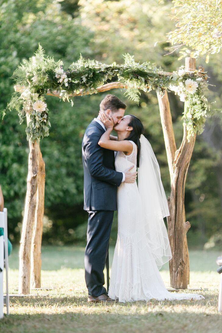 Newlyweds' First Kiss Under Birch Wedding Arch