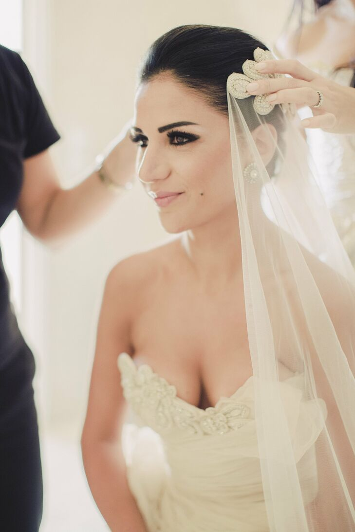 Miriam chose to go with a dark eye and nude lip for her destination wedding in Greece. Renia Bledaki in Greece did the bride's makeup, and Georgia Theodoraki did her updo.