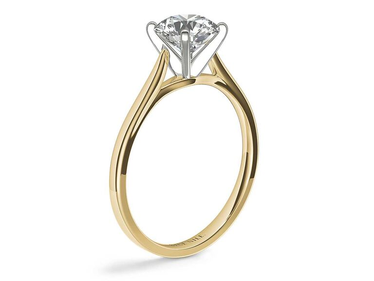 Blue Nile petite cathedral solitaire engagement ring in 14K yellow gold