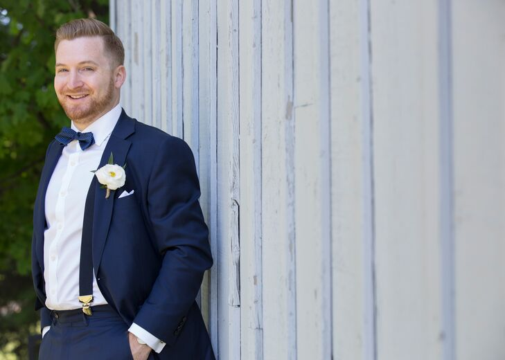 Graeme fused classic and modern styles to fit the Barns at Wesleyan Hills's laid-back vibe and the Memorial Day theme. He chose a traditional navy suit from Suit Supply in New York City and paired it with a navy bow tie, suspenders and an oversized floral boutonniere.