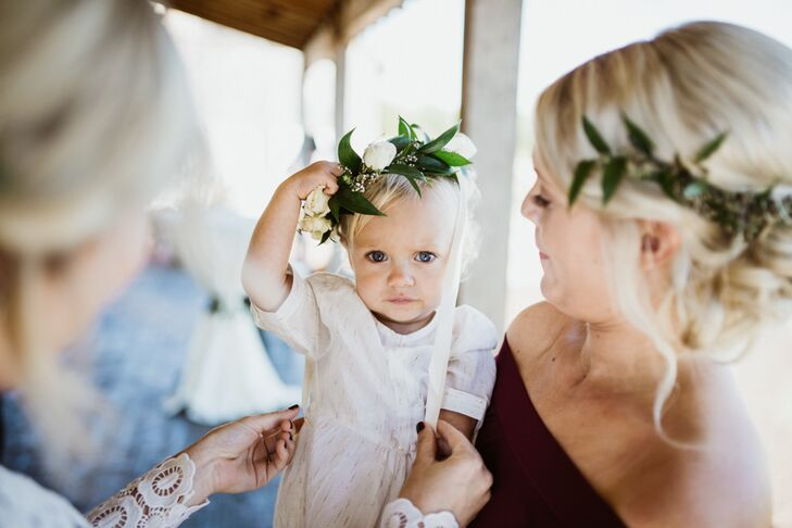 "Laura and Austin's daughter, Ruthie, wore a floral headpiece ""for about 20 seconds,"" Laura says."