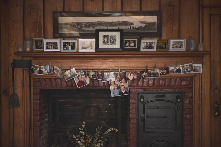 Family photos in frames stood on the mantelpiece. Loose photos were hung from the mantelpiece with twine and clothespins.
