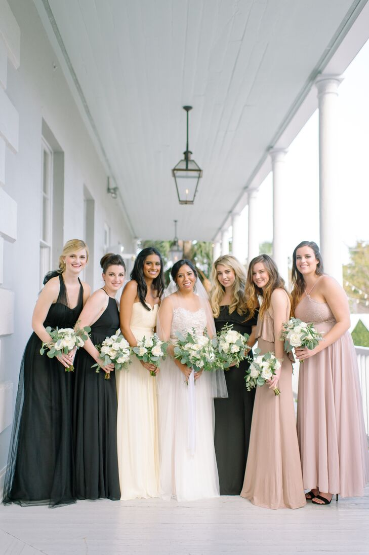 """""""For the bridesmaid dresses, I was inspired by my matron of honor's wedding,"""" Jennifer says. """"She gave us a color and length and then let us find our own bridesmaid dresses."""" Jennifer directed her brides to purchase a long gown in black or beige. """"My bridesmaids had dresses that not only fit them perfectly but also captured their individual personalities. I loved that they all looked so beautiful and felt so comfortable in their dresses."""""""