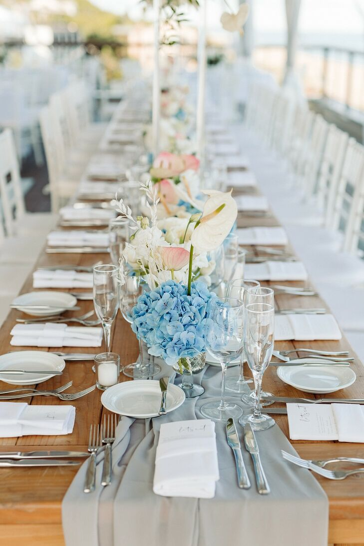 Elegant Farm Table with Blue Runner and Flower Centerpieces