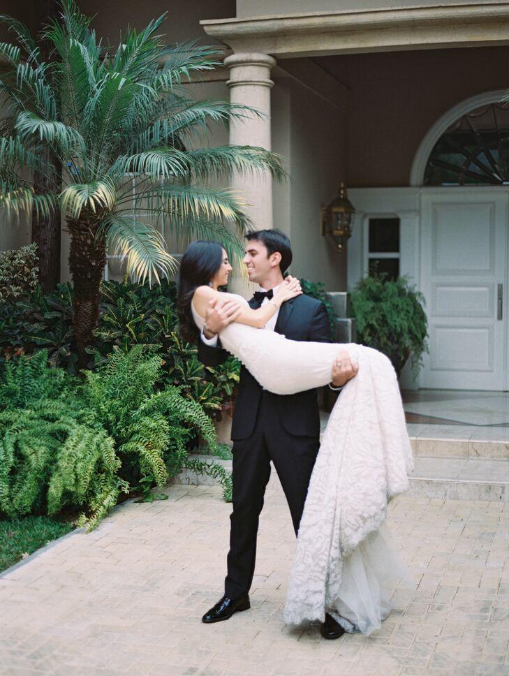 Monique's romantic mermaid-style Inbal Dror gown was a perfect match for Gabriel's classic black Hugo Boss tuxedo.