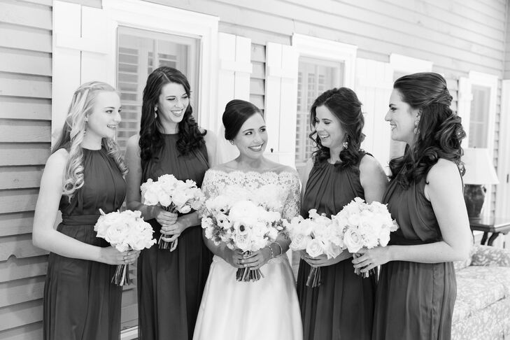 Emily's sister was her maid of honor, and her three best friends were bridesmaids. They all wore the same hunter green chiffon dresses by Lela Rose. Emily and Edward loved how the green popped against the snow. Emily gave the bridesmaids sparkly drop earrings from BaubleBar to complete their look.