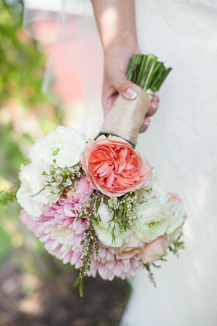 Posh Petals florist designed this romantic bouquet for the bride made from garden roses and ranunculus.
