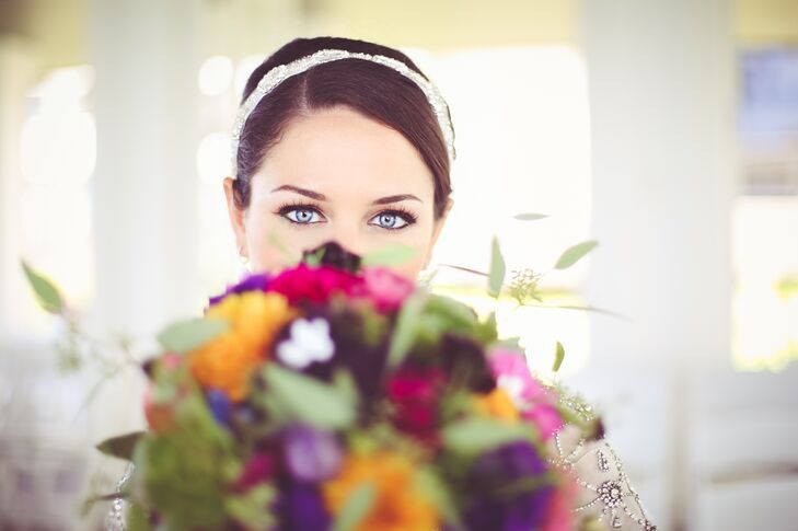 Bride's Dramatic Eye Makeup, Updo and Headband, and Colorful, Tropical Bouquet