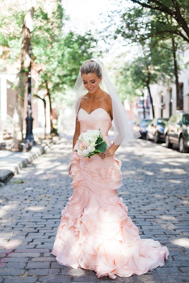 """Cecilia wore a custom-made, pink dress designed by Project Runway winner Leanne Marshall. """"I knew I wanted pink and that it had to be unique,"""" Cecilia says. """"I wanted it to make more of a fashion statement than a traditional wedding dress would."""""""