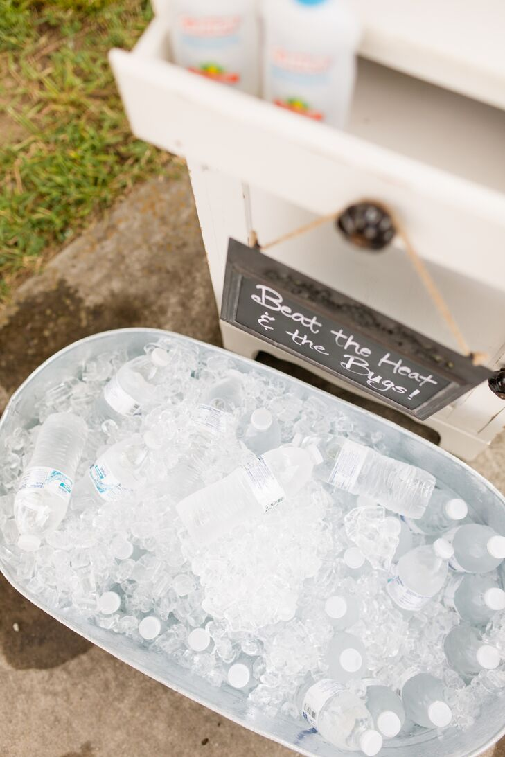 To help keep guests comfortable during the outdoor ceremony, Alix and George made sure to provide guests with a few warm-weather essentials. When guests arrived to the ceremony site, they were greeted with bottled water, bug spray and fans that would help keep them cool and free of pesky mosquito bites.