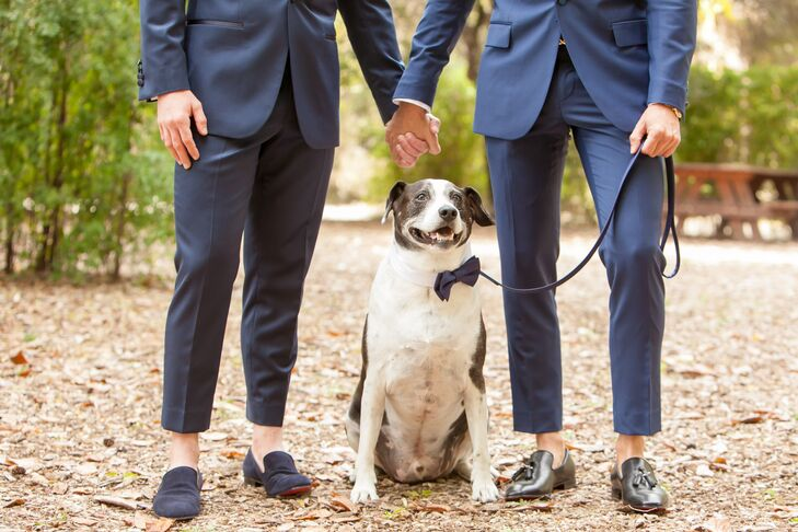 """Renato and Patrick had their navy tuxedos tailored to be slightly shorter. """"We decided to have them tailored and cropped since we wanted to wear loafers,"""" Renato says. Their dog—outfitted in a bow tie as well—was part of the wedding procession."""