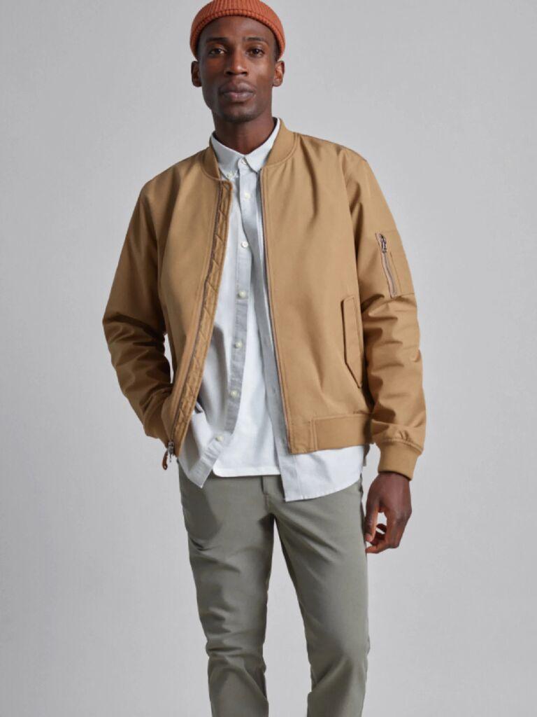 Man wearing beige bomber jacket Valentine's gift idea
