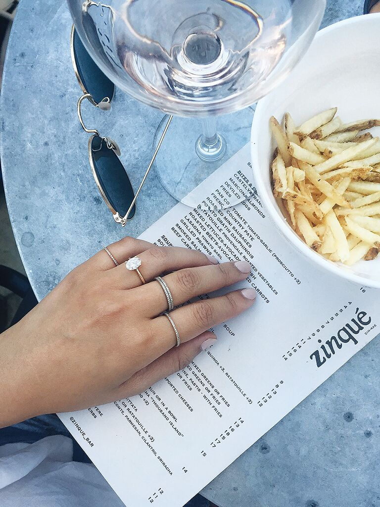 Casual engagement ring selfie idea with wine and french fries