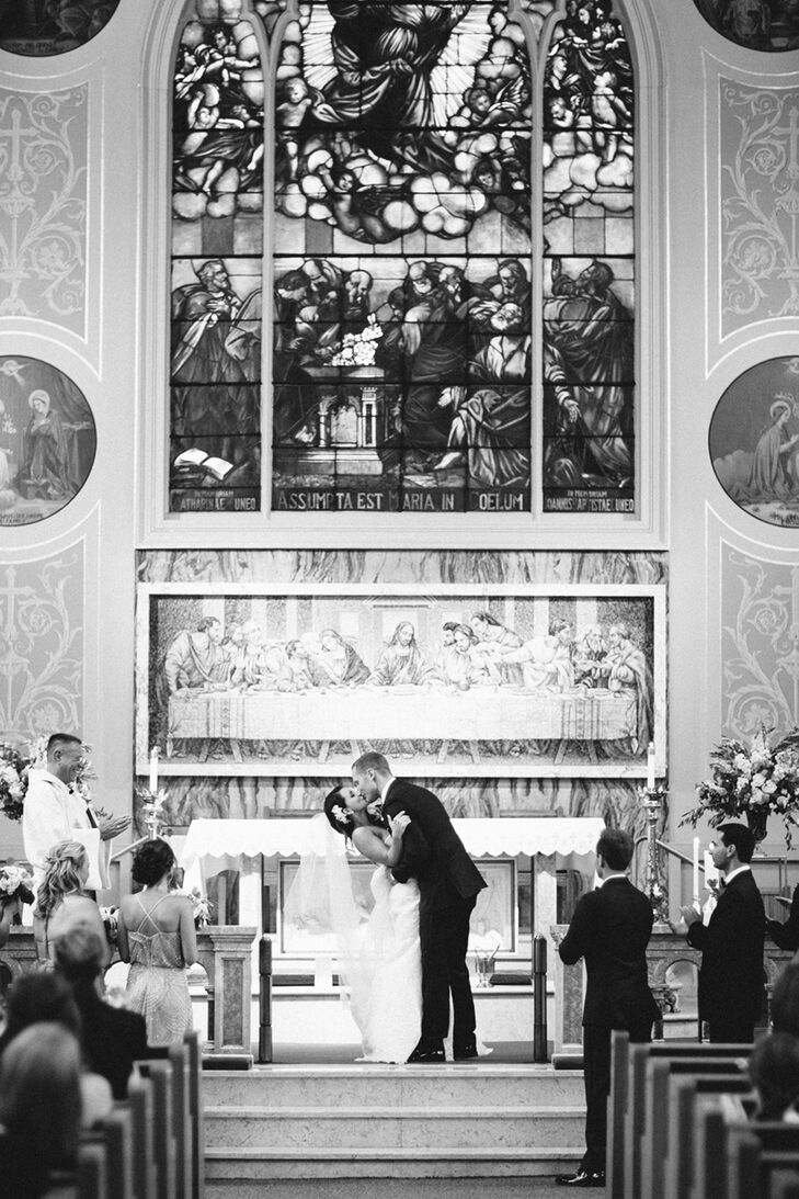 """The large stained-glass window above the altar at Assumption Catholic Church is patterned after a number of famous paintings, including El Greco's """"The Assumption of the Virgin,"""" part of the collection at the Art Institute of Chicago. The church was founded in 1881 to serve Irish immigrants."""