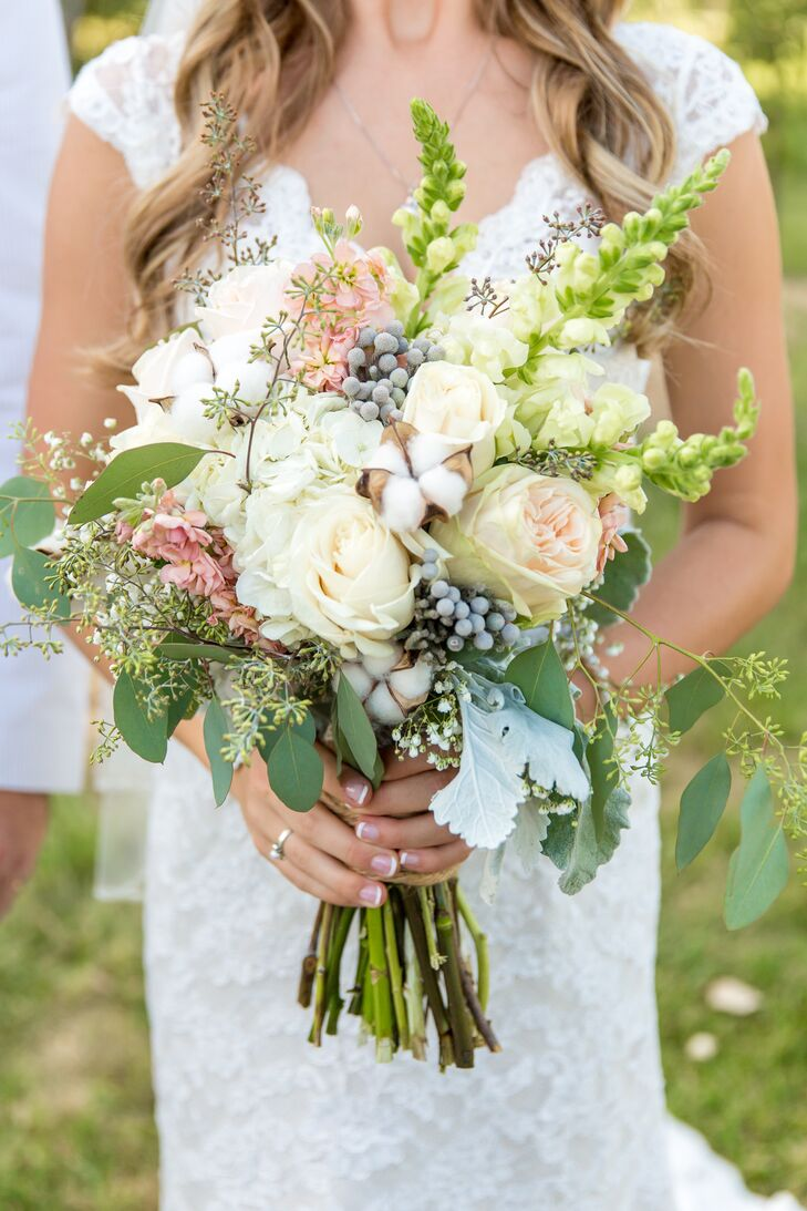 Fresh Flower Market created all the floral arrangements for the rustic wedding. Leslie told the florist she wanted the flowers to be light and airy, and they nailed it! The bride carried roses, stock, baby's breath, silver brunia, seeded eucalyptus, dusty miller and hydrangeas down the aisle.