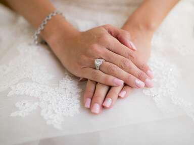 Bride with hands folded on her lap