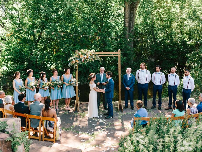 Bride and groom reciting vows at wedding ceremony