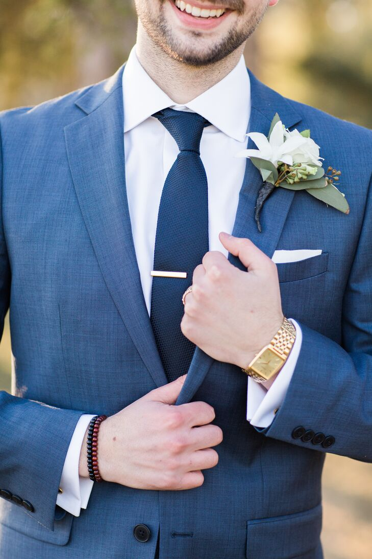 """Even the groom stuck with a """"something old"""" mantra  by pairing used cuff links with a blue suit, wine-colored Aldo shoes (something new) and a gold wristwatch borrowed from his grandfather. """"Girls aren't the only ones who get to have fun with the accessories,"""" he says."""