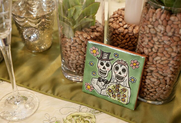 To tie into the desert theme, the couple incorporated Mexican Talavera Tiles with bride and groom sugar skulls into the tablescapes.