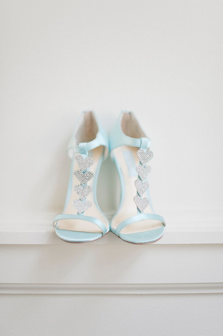 While Katie's dress was all elegance, she took a more playful approach to her accessories. For her shoes, she chose a pair of Betsey Johnson steppers in a pale blue color with shimmery silver hearts dotting the straps. The shoes tied into the wedding's blue and orange color scheme, while also serving as her something blue.