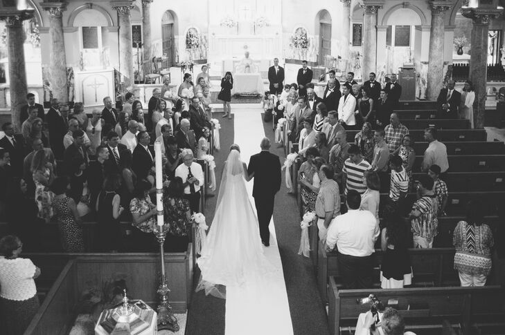 """Our ceremony was the most special part of our day. Our faith is very important to us, and it meant so much to us to be married by Father Joe at St. Mary of Mount Carmel,"" Morgan says of the traditional Catholic ceremony."