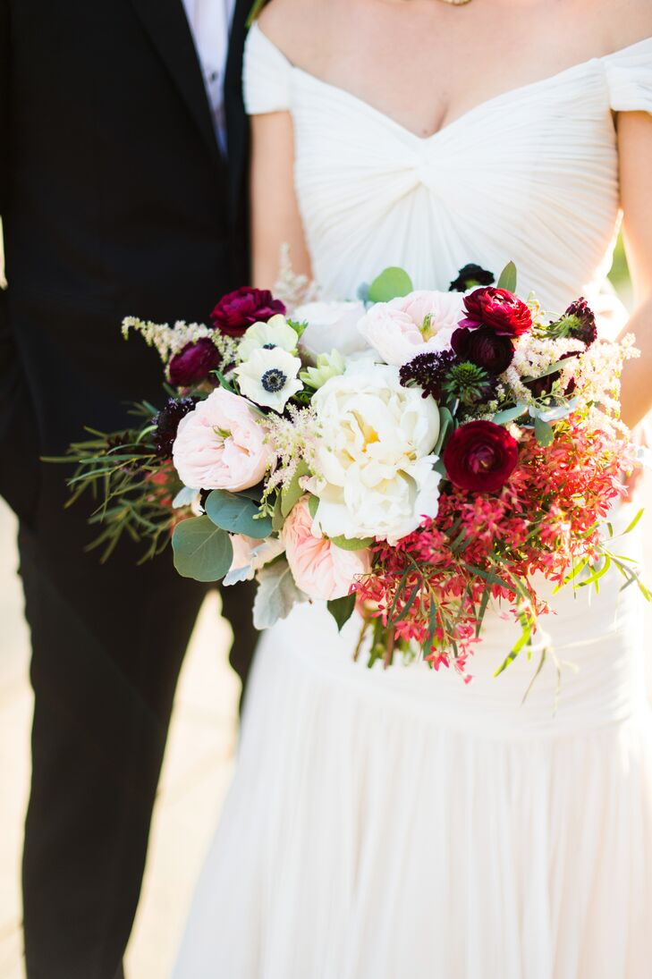 Filled with anemones, garden roses, eucalyptus, scabiosas, ranunculus and more, Susan's bouquet took on a romantic, textured feel that was heightened by the contrast of soft pastel and dramatic dark hues.