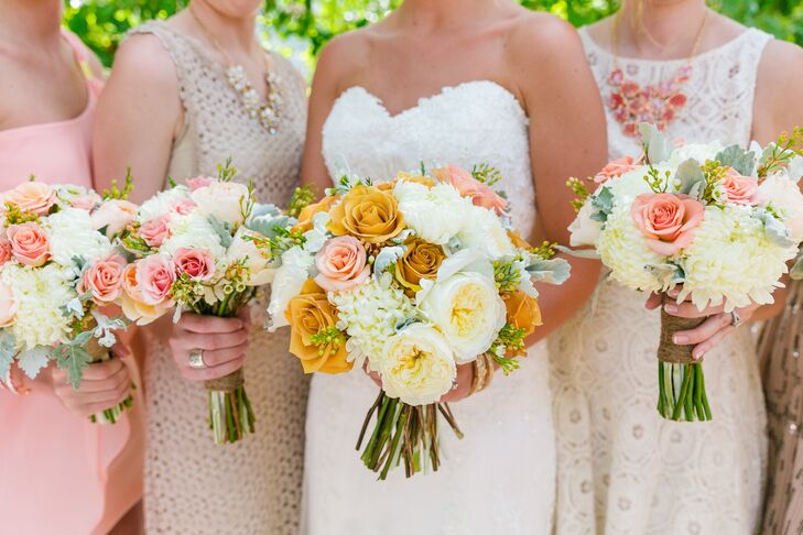 The bridal bouquet was a soft mix of ivory garden roses, white chrysanthemums and golden roses.