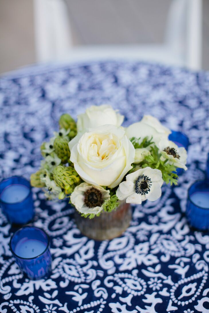 Small white rose centerpieces topped the cocktail hour tables.