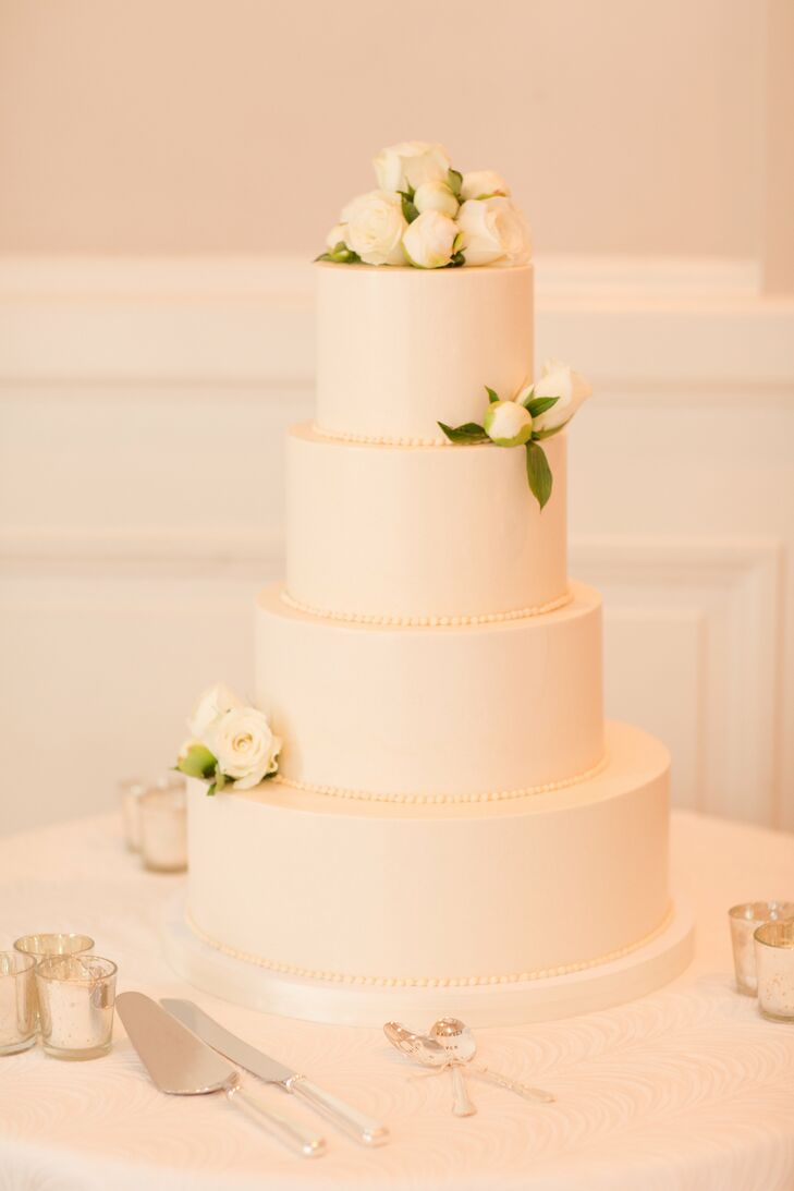The crisp, white wedding cake, provided by Fluffy Thoughts Bakery, had a layer of coconut cake with vanilla cream cheese frosting and toasted coconut flakes. The other layers were chocolate with vanilla buttercream frosting and dark chocolate ganache.