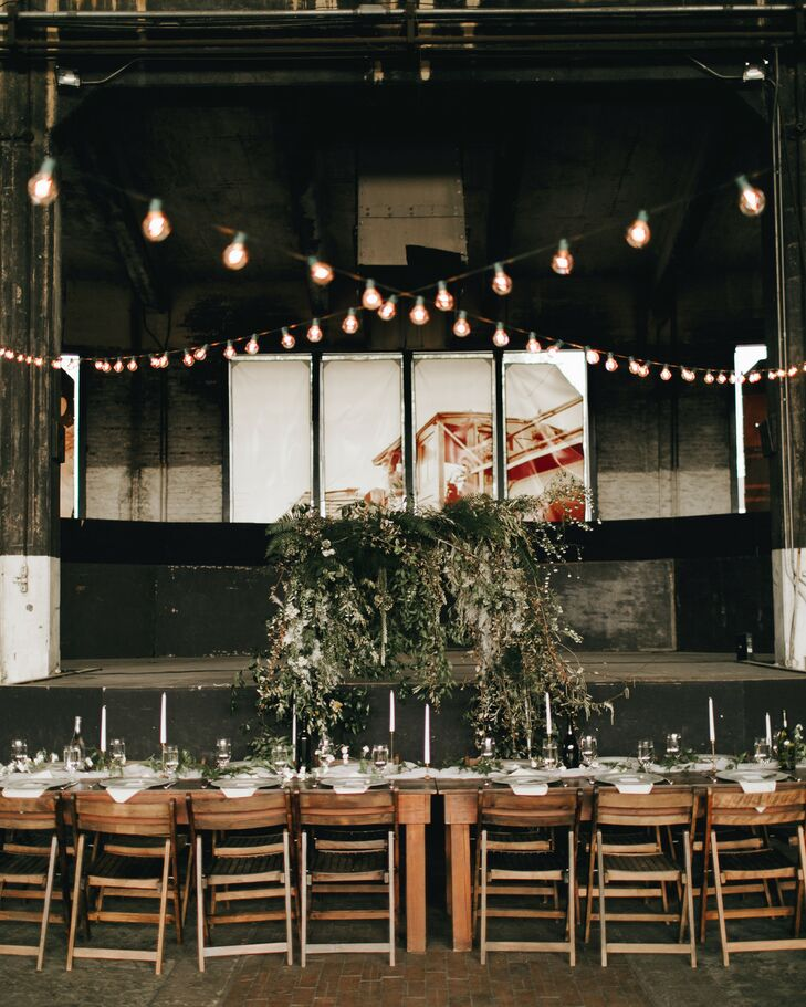 Rustic Reception with String Lights and Wood Tables at Georgia State Railroad Museum