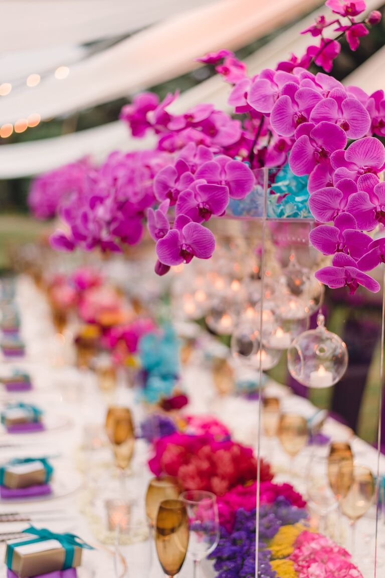 Tall purple orchid reception centerpiece
