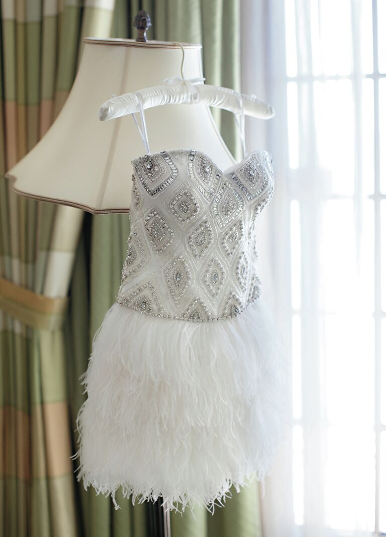 Short reception dress with feather skirt and embellished bodice