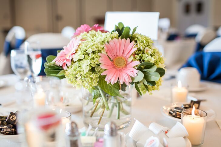 Large pink gerbera daisies complemented light green bunches of hydrangea for the romantic centerpieces.