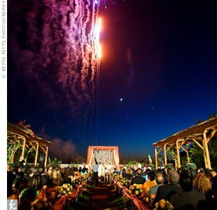 The couple's married life started with a bang! Fireworks lit up the sky right as they were pronounced husband and wife.