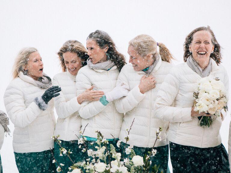 winter wedding ideas matching puffer jackets