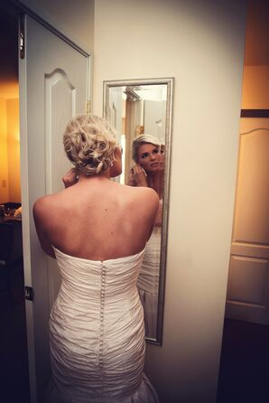Bride Getting Ready in Mirror with Curled Updo in Monclova, Ohio