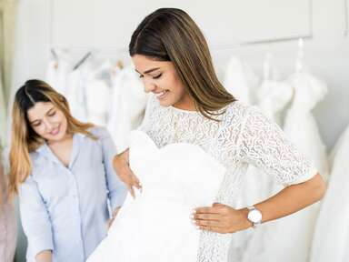 bride wedding dress shopping with two other women