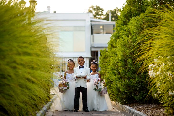 The youngest members of the wedding party looked to Nkenna and Ekwere for inspiration when it came to matters of style. The ring bearer wore a white dinner jacket tuxedo that complemented Ekwere's own, while the two flower girls wore tulle ball gowns with 3-D floral bodices that channelled Nkenna's YSA Makino gown.